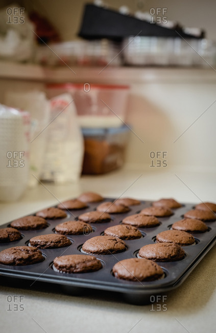 Freshly baked cup cakes in oven tray
