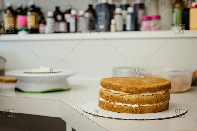Three layered cake with whipped cream