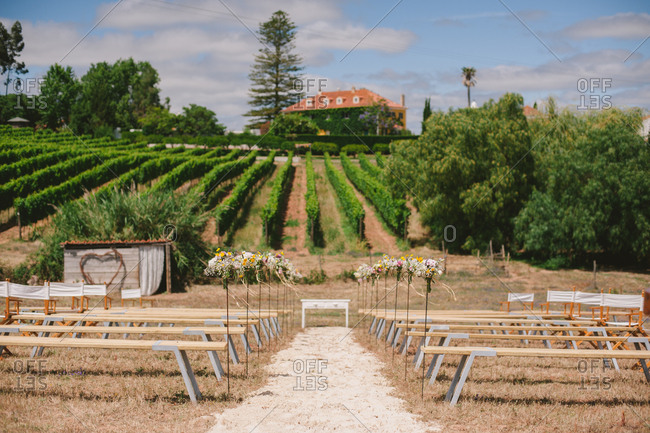 Outdoor wedding ceremony set up at a wine farm in Mafra, Portugal