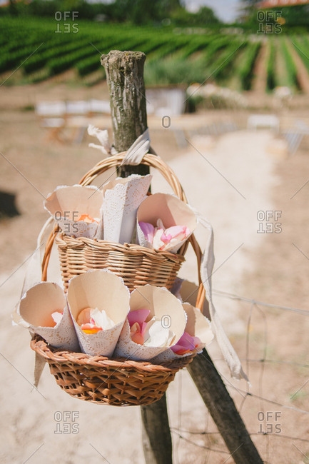 Rose petals in baskets at an outdoor wedding ceremony in Mafra, Portugal