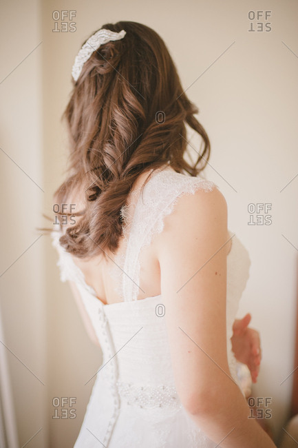 Rear view of bride with brown curled hair