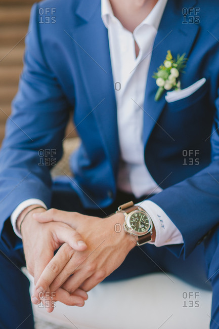 Groom wearing blue suit and wristwatch