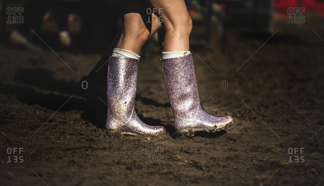 Glittery boots walking through mud