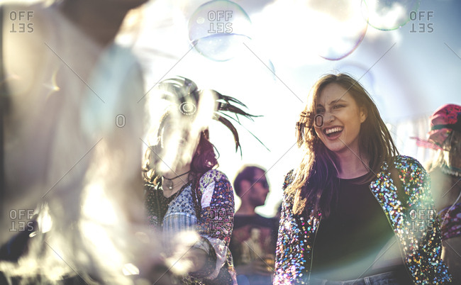 Women at a music festival dancing around bubbles