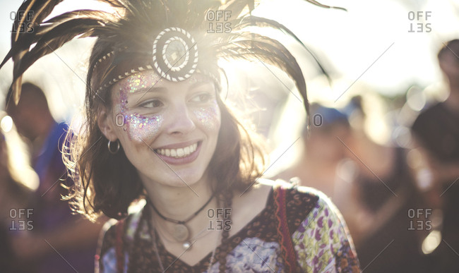 Young woman at a concert wearing feather headdresses