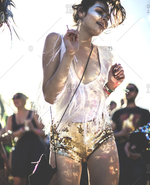 Brunette woman dancing at a music festival