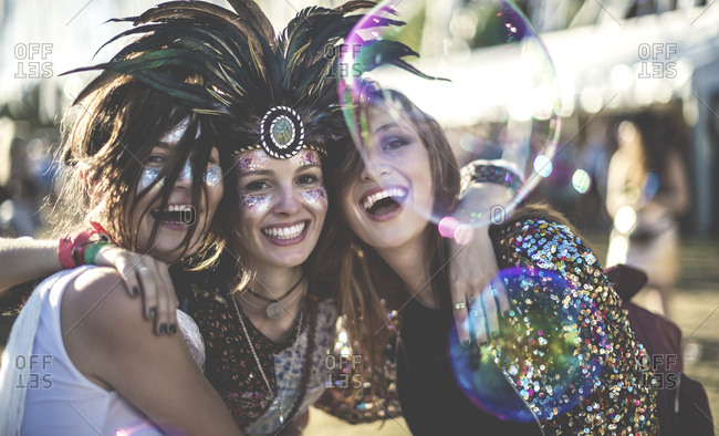 Smiling women dressed up at a music festival
