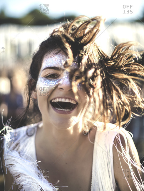 Excited woman dancing at a music festival