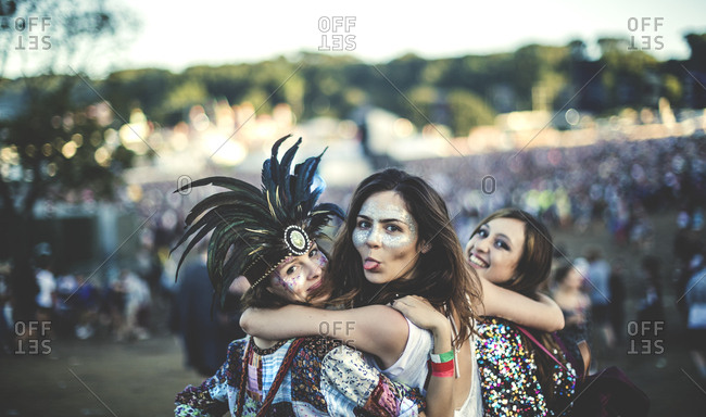 Happy young women at a music festival