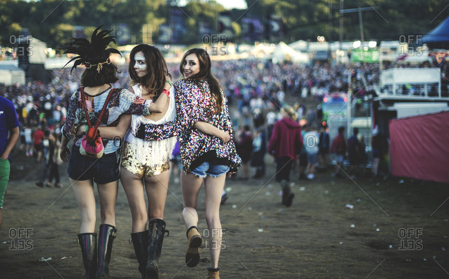 Rear view of happy young women at a music festival