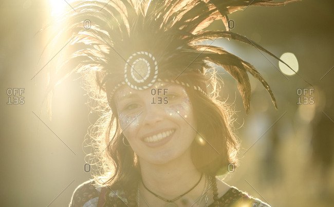 Young woman wearing feather headdress
