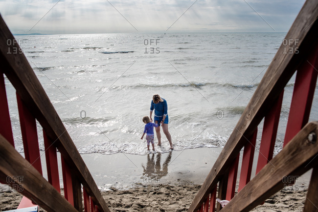View from lifeguard chair of mother and child at beach