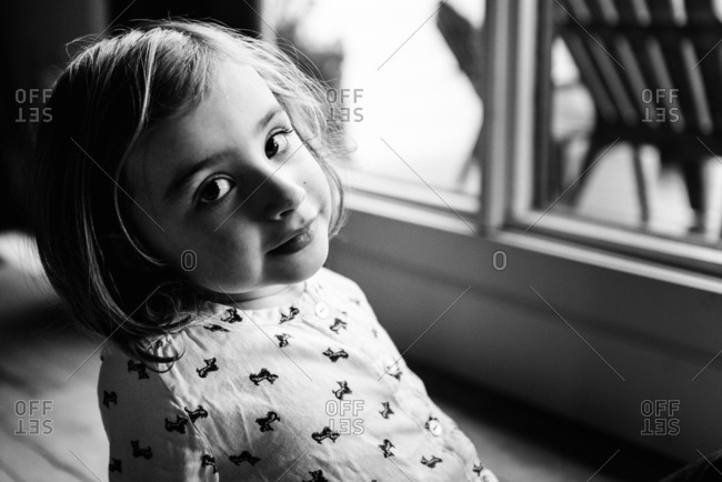 Black and white portrait of little girl wearing shirt with Scotties on it