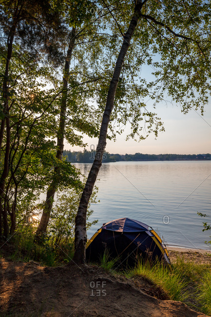 Camping tent at the lakeshore