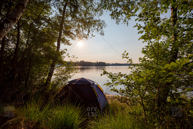 Camping tent at lake's edge