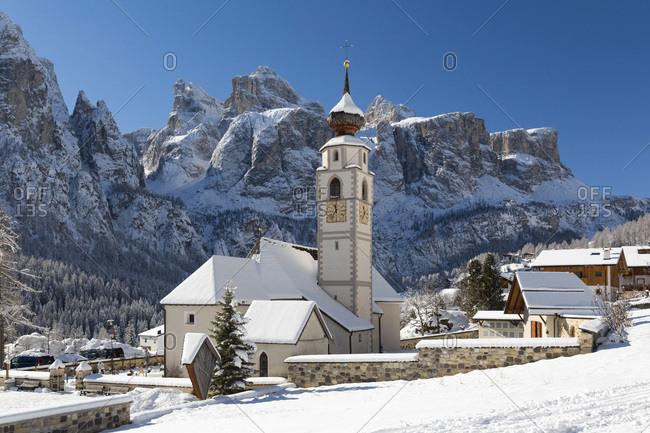 Italy, Trentino-Alto Adige, Bolzano district, South Tyrol, Alta Badia, Colfosco, Alps, Dolomites, Church towards Sella Group