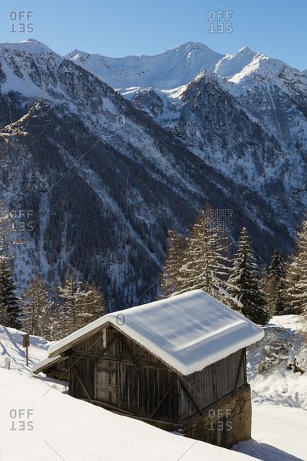Italy, Trentino-Alto Adige, Trento district, Trentino, Val di Sole, Val di Pejo, Alps, Dolomites, Stelvio National Park, Peio 3000 ski area, cabin wood near Covel area, val del Monte in the back
