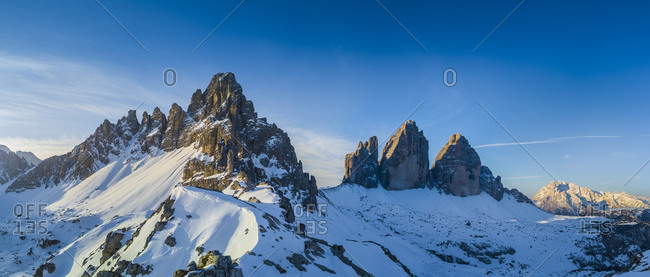 Italy, Trentino-Alto Adige, Bolzano district, South Tyrol, Alta Pusteria, Dolomiti di Sesto Natural Park, Alps, Dolomites, Winter Sunrise in the dolomites with Paterno and Tre Cime di Lavaredo (Drei Zinnen) (Aerial Photo)