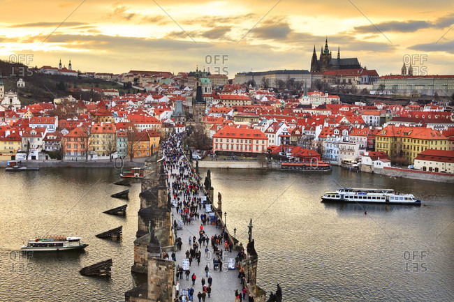 March 5, 2017: Czech Republic, Central Bohemia Region, Prague, Charles Bridge, Bohemia, Vltava, Checy, Vltava (Moldova) river and Hradcany castle and St Vitus cathedral in background