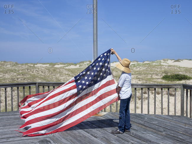 Person raising the American flag
