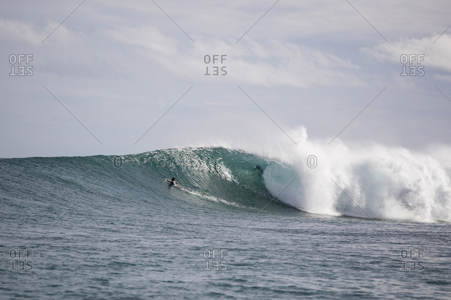 Surfer getting ready to ride a wave
