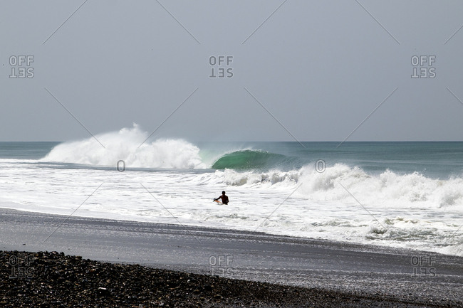 Surfer in the waves on the coast of Mexico