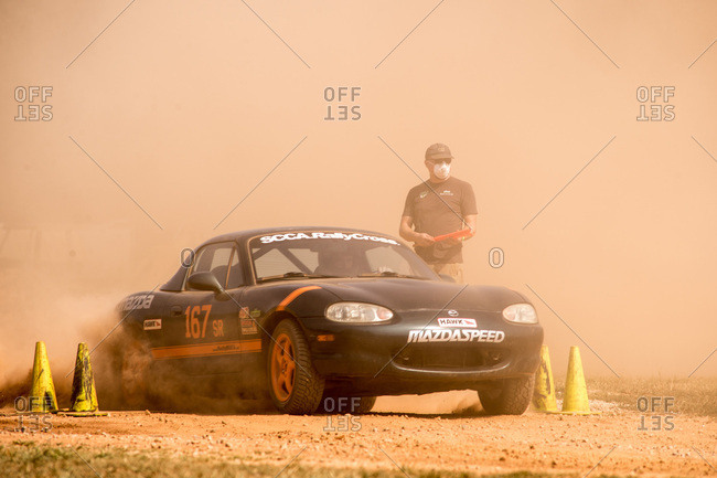 Union Point, Georgia, USA - July 26, 2015: Worker standing next to Mazda Miata at motorsport event at off-road resort