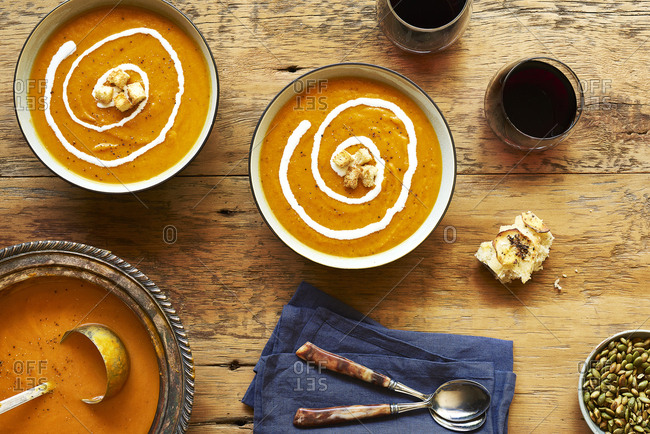 High angle view of squash soup served on wooden table