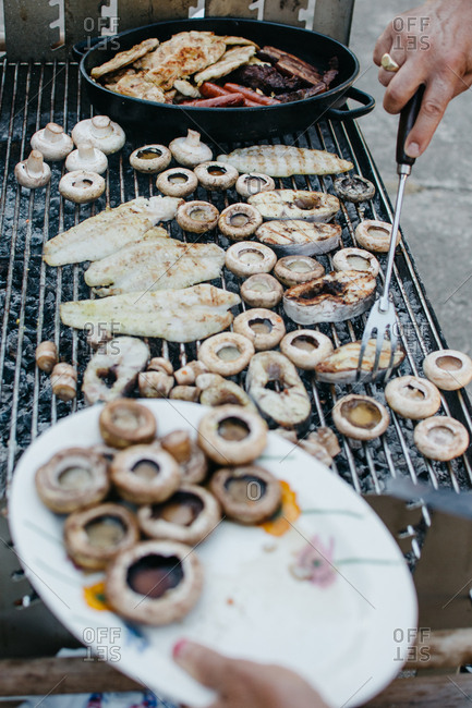 Grilled mushrooms and meats at a barbecue