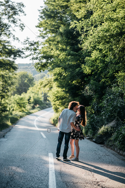 Young couple kissing on the road