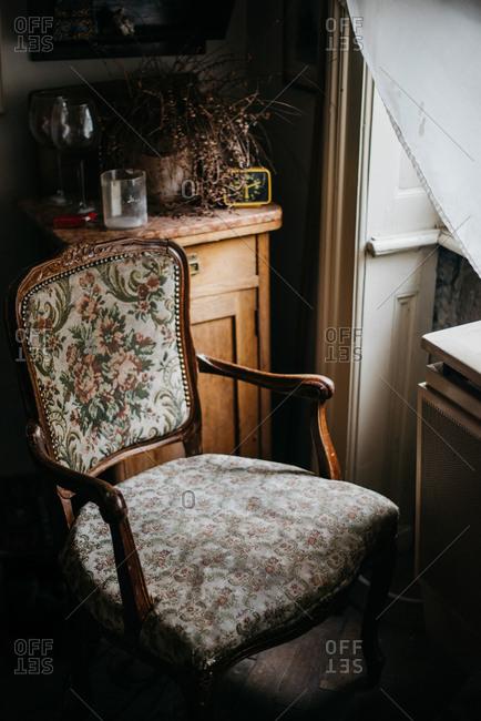 Antique chair beside a window