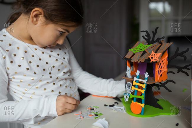Girl assembling a Halloween craft