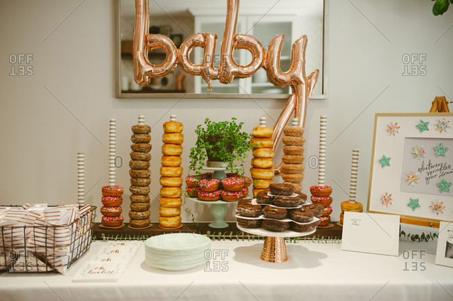 Decorated dessert table with doughnuts at baby shower