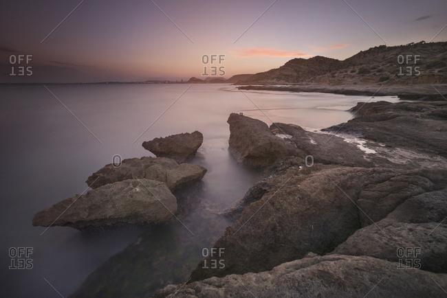 Spain Alicante- Rock coast at dusk
