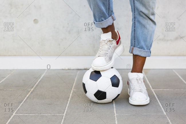 Man's feet with soccer ball