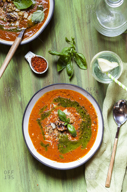 Soup made of roasted bell pepper with walnuts and pesto