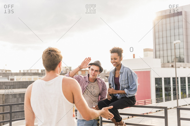Friends meeting on a rooftop party
