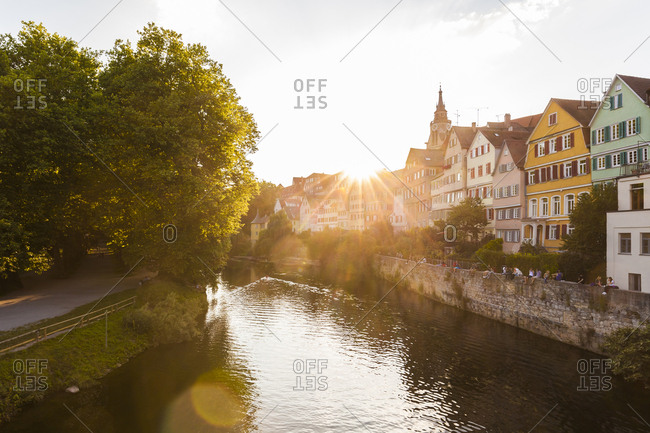 July 17, 2017: Germany- Tuebingen- view to the city with Neckar River in the foreground at evening twilight