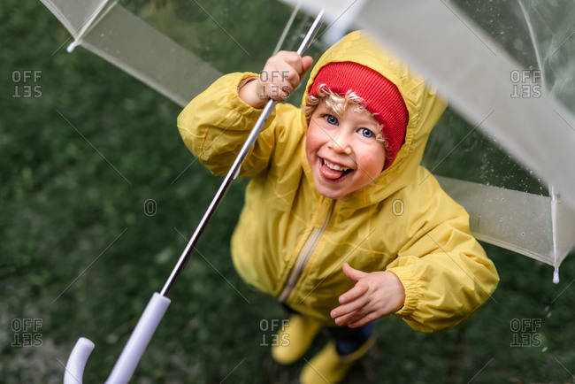 Boy under umbrella in rainy weather