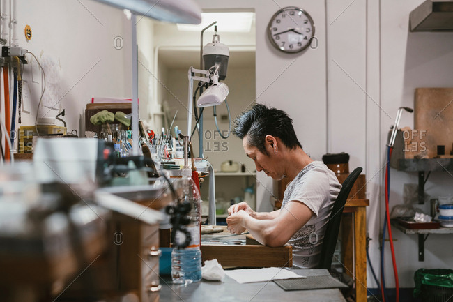 Male jeweller working at workbench