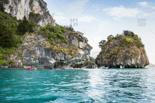 Man kayaking around marble caves, Puerto Tranquilo, Aysen Region, Chile, South America