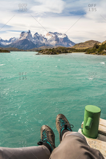 Male hiker's personal perspective over Grey Lake and Cuernos del Paine, Torres del Paine national park, Chile