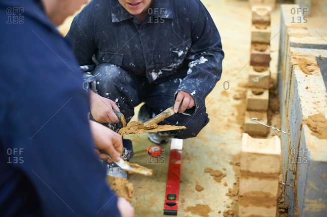 Student learning how to do building work