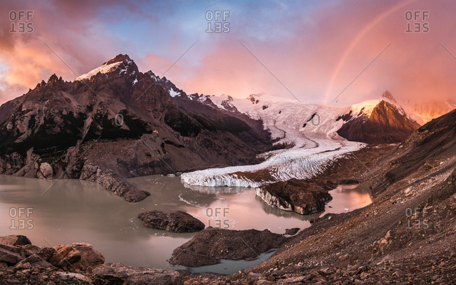 Rainbow and dramatic pink sky over Torre glacier and laguna in Los Glaciares National Park, Patagonia, Argentina