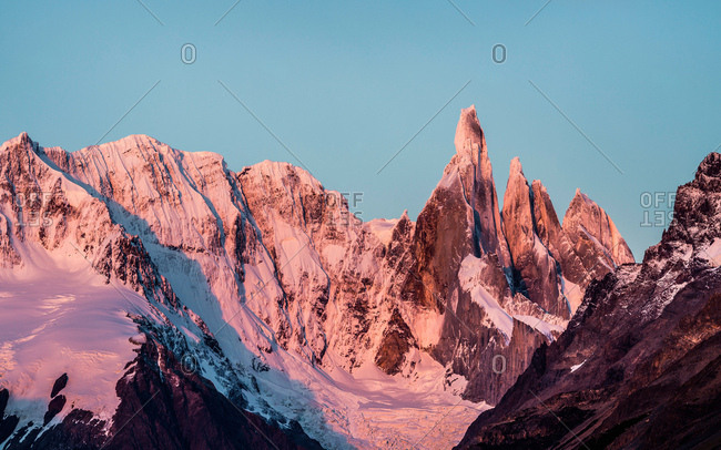 Pink sunset view of Cerro Torre and Fitz Roy mountain ranges Los Glaciares National Park, Patagonia, Argentina