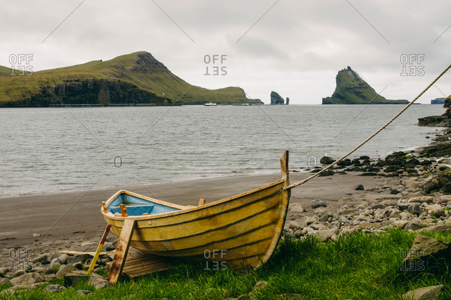 Boat on shore, Tindholmur in the background, Bour, Faroe Islands, Denmark