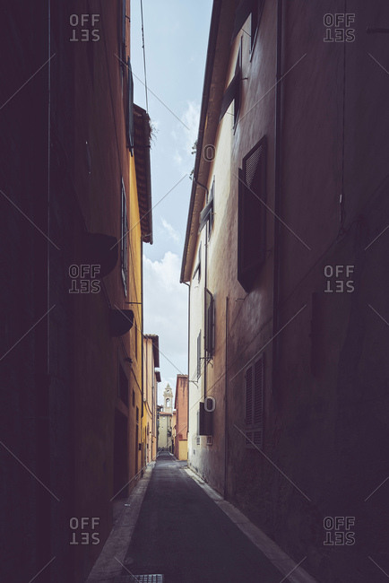 Narrow shadowed alleyway, Pisa, Tuscany, Italy