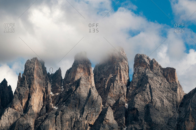 Low cloud over jagged Odle mountain skyline, Funes Valley, Dolomites, Italy