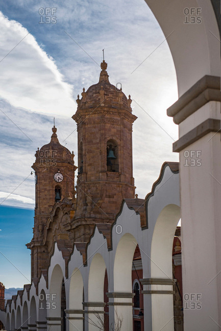 View of church bell tower and clock tower, Potosi, Bolivia