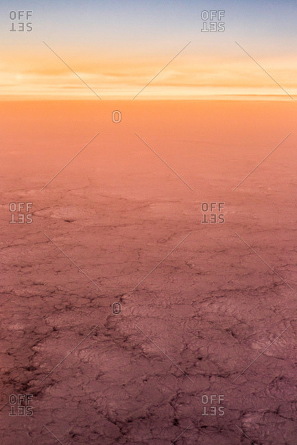 Aerial view of glowing arid landscape at sunset, Metropolitan Region, Chile